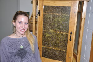 Nature Instructor Michelle with our observation bee hive.